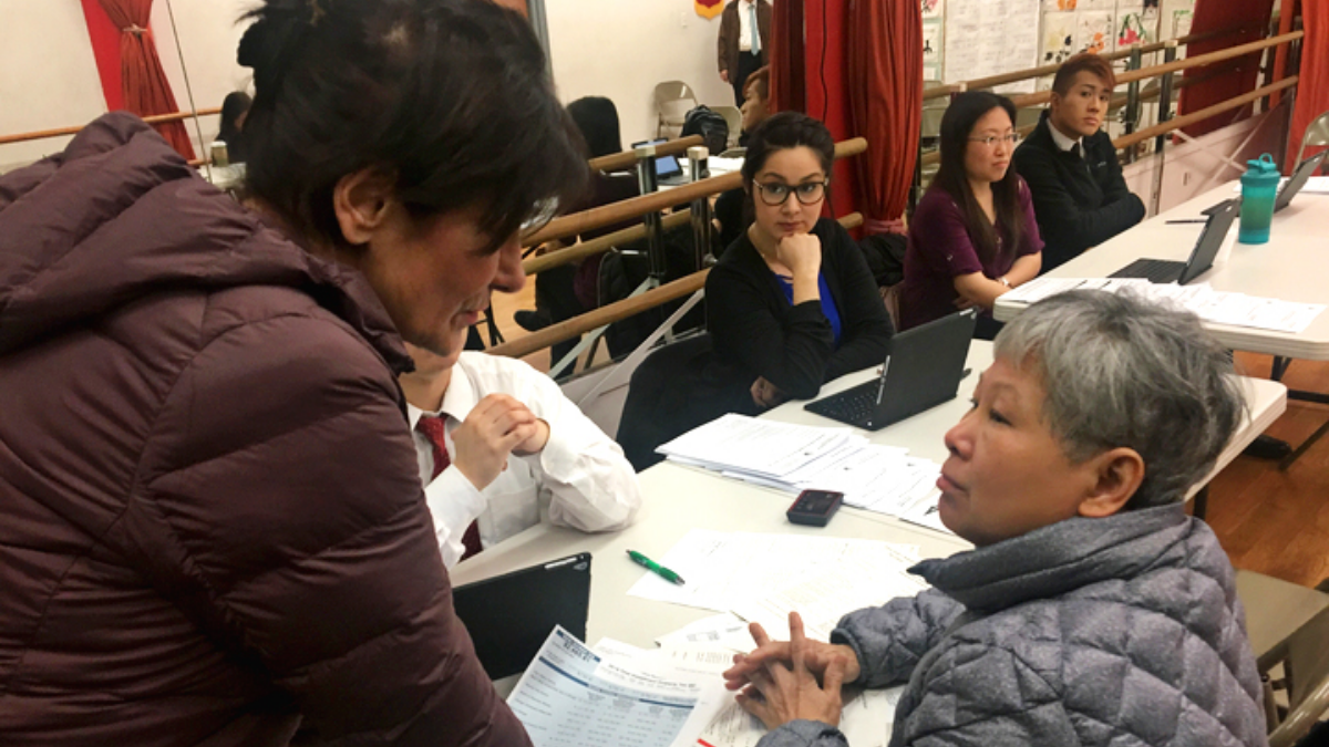 Cook County Treasurer Maria Pappas (left) has held outreach events throughout the county ahead of the annual tax sale. Earlier this week, she spoke with homeowner Cathy Huynh at an event in Chicago's Chinatown.