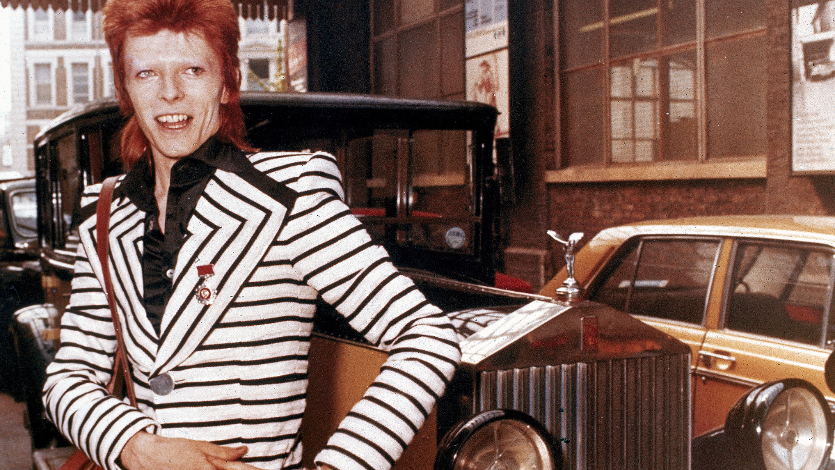British rock singer, David Bowie, poses beside his Rolls Royce in May 1973. (AP Photo/File)