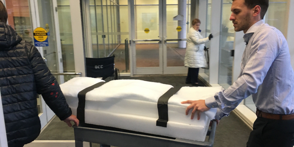 Researchers wheeled Sue's bones through UIC's Outpatient Care Center on Tuesday afternoon en route to a CT scan. (Kate McGee/WBEZ)