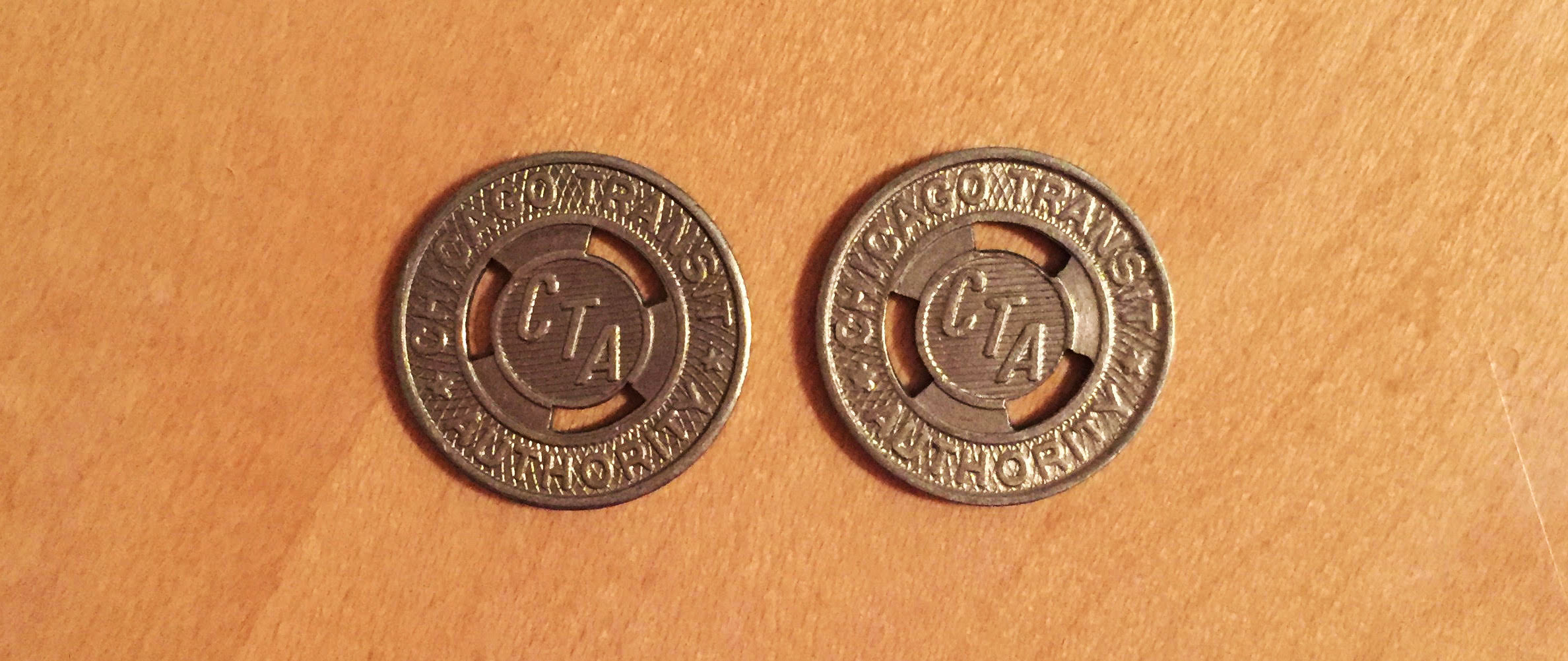 Two brass CTA tokens, sent to questioner Sadie by her mother, prompted her to ask Curious City about the history of the now-obsolete transit fare. (Courtesy Sadie Teper)