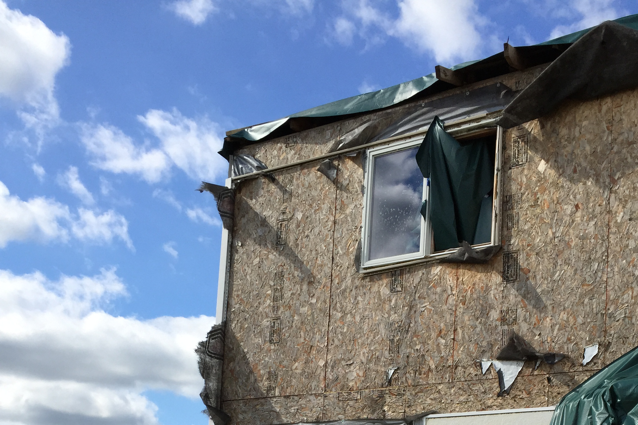 The back of Reno Vognocchi's house after the tornado in 2015. The foundation of the house was strong enough for Vognocchi to rebuild from the bricks and the studs.     (Courtesy of Reno Vignocchi)