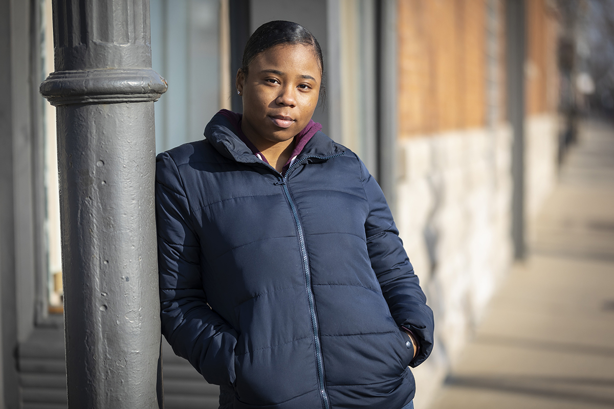 Manaja Miller, 19, has been looking for a job in Chicago's Marshall Square neighborhood. Miller graduated from high school in June and had planned to attend college this fall, but she didn't end up enrolling. She's one of thousands of Illinois students every year who are accepted, but don't make it to college. (Manuel Martinez/WBEZ)