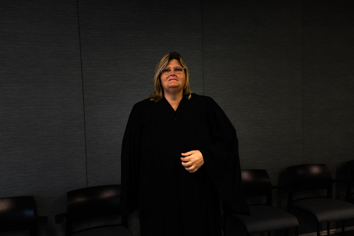Judge Colleen Sheehan stands in the courtroom. (Sebastián Hidalgo/City Bureau) Sheehan worked to bring a restorative justice court to Cook County under a directive from Chief Judge Timothy Evans.
