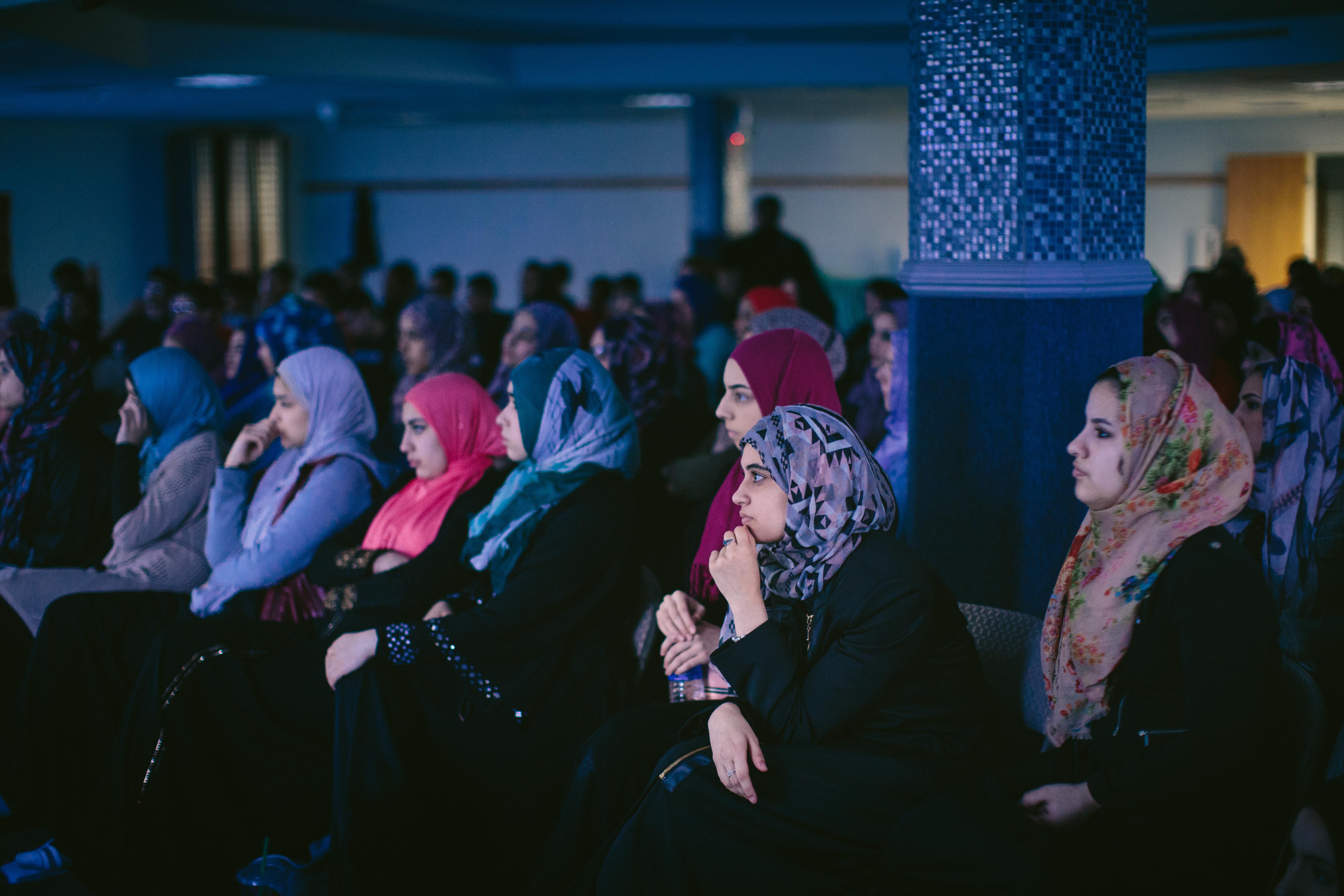 Young Muslim women listen to a testimonial at The Prayer Center of Orland Park. (Alyssa Schukar/For WBEZ)