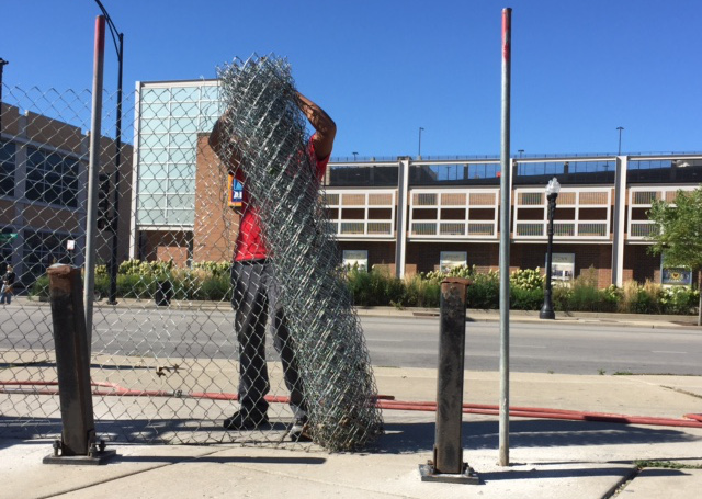The city puts up a fence around the former site of Steward School, where Uptown residents have been living in a homeless encampment. Alderman James Cappleman said construction on the site would make it an unsafe area for people to live in.(Shannon Heffernan/WBEZ)