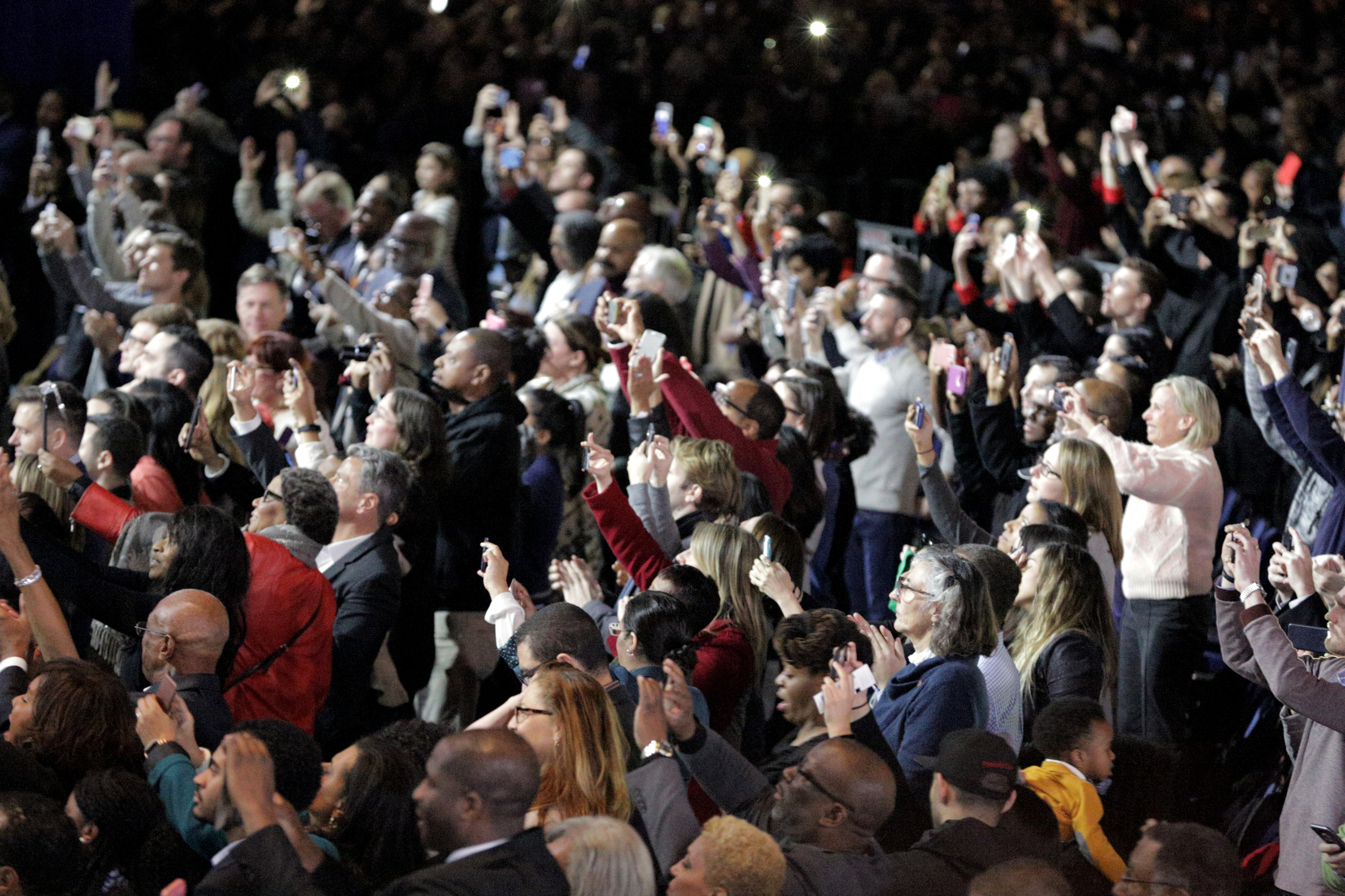 The crowd at McCormick Place reacts to Barack Obama during his farewell speech Tuesday in Chicago. (Andrew Gill/WBEZ)