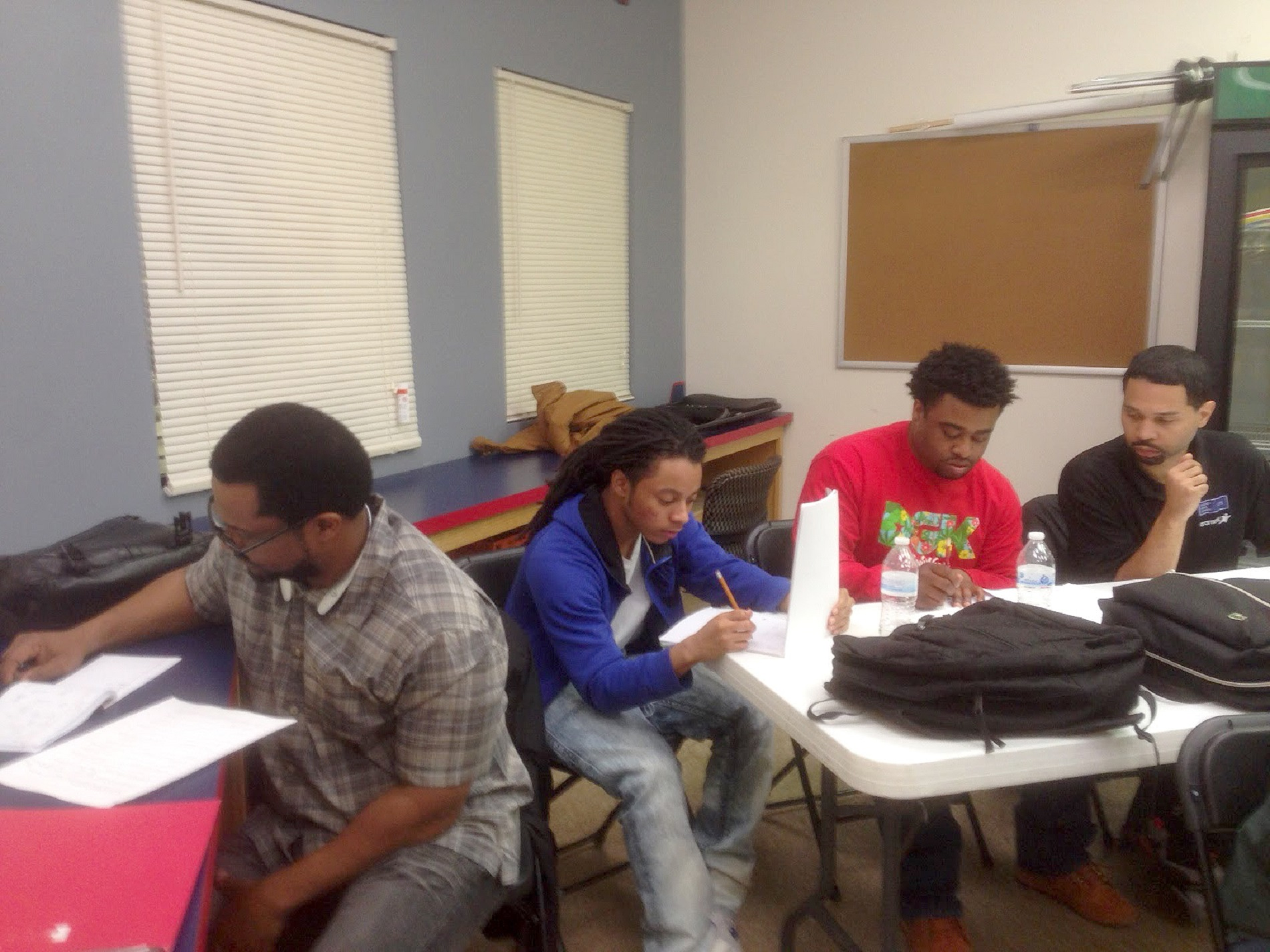 Students in a job-training program at Austin People's Action Center had computers to work on, until late March, 2016, when a state agency reclaimed them. Now they do their work on paper and pencil. (WBEZ/Dan Weissmann)