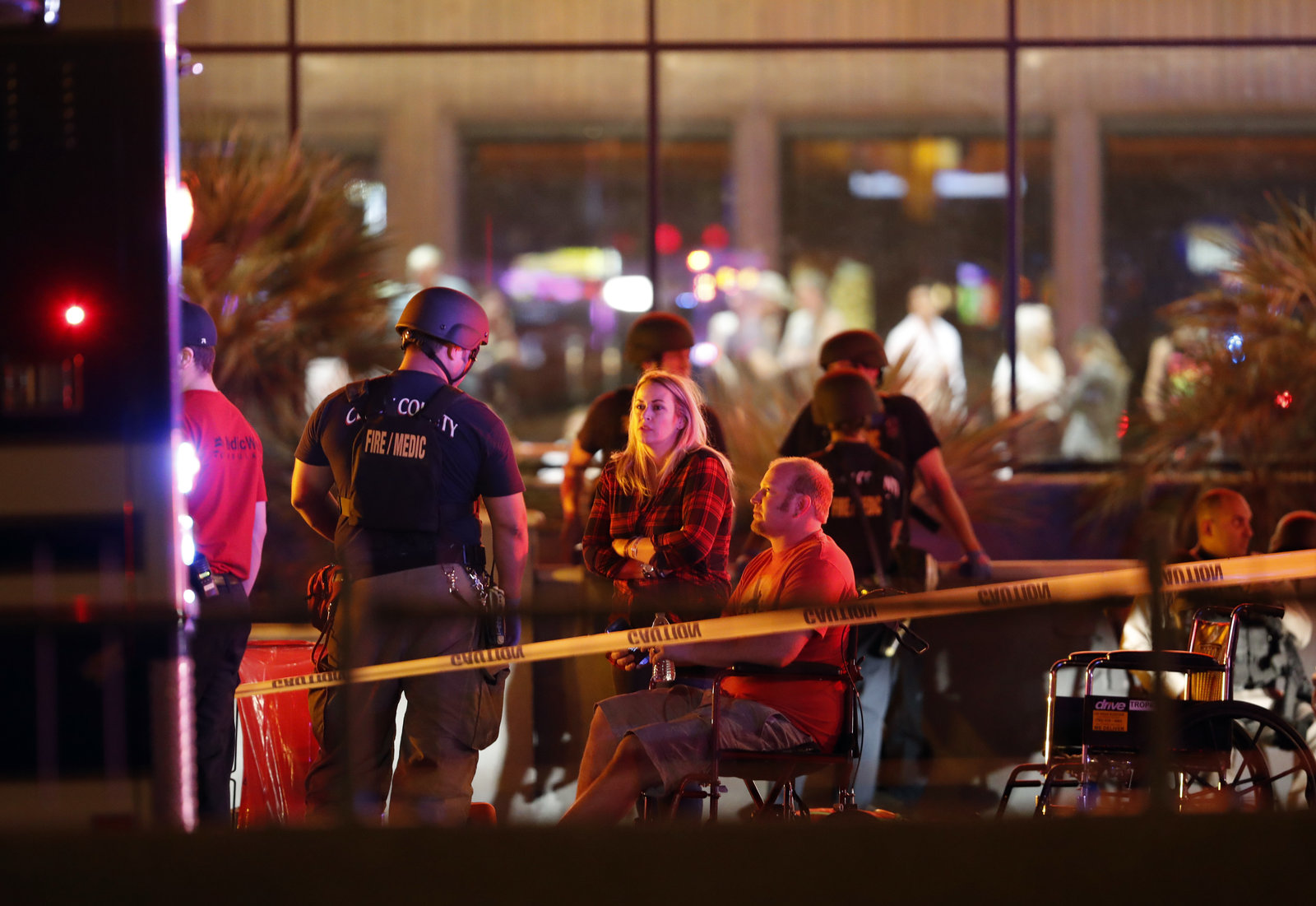 People wait in a medical staging area on Monday, after a mass shooting during a music festival Sunday on the Las Vegas Strip. Police say Stephen Paddock fired down at the crowd of more than 22,000 people from his room on the 32nd floor of the Mandalay Bay Resort and Casino. (Steve Marcus/Courtesy of Las Vegas Sun)