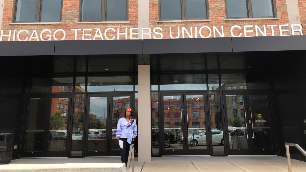 CTU Political Director Stacey Davis Gates stands in front the union's new headquarters. The new building has generated some controversy. (Sarah Karp/WBEZ)