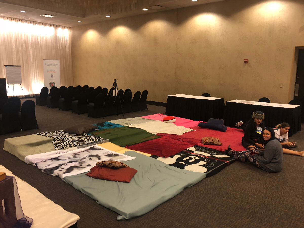 Sleeping mats line a conference room at the Crowne Plaza O'Hare Hotel. (Miles Bryan/WBEZ)