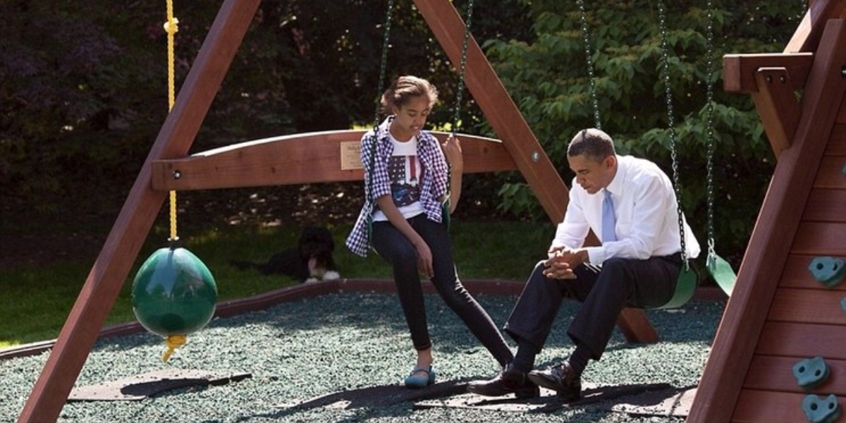 The President and his daughter Malia Obama on the White House swing set in May 2010 (Pete Souza)