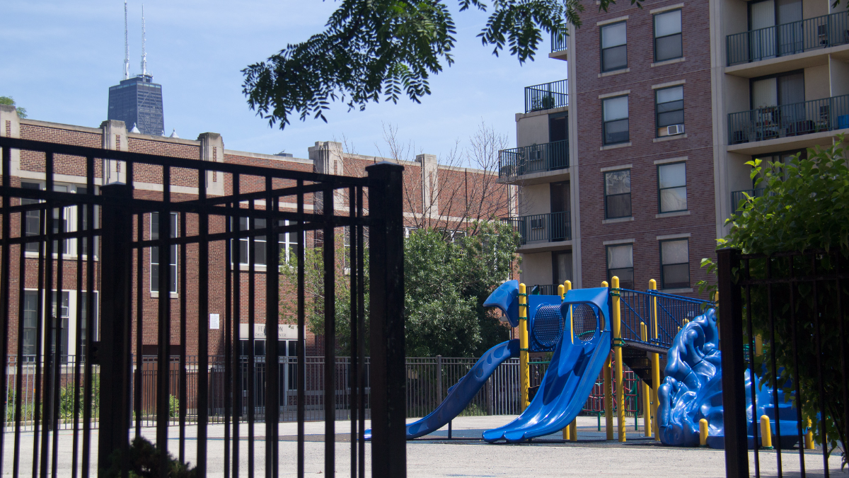 Manierre Elementary's playground sits behind the school, across from million dollar homes. The school's principal says students are discouraged from playing there after school. (Andrew Gill/WBEZ)