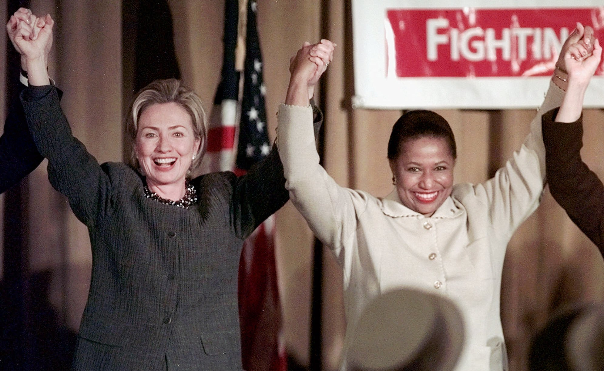 Then-First lady Hillary Rodham Clinton raises hands with then-U.S. Sen. Carol Mosely-Braun, D-Ill., on Oct. 23, 1998, in Chicago. (AP Photo/Michael S. Green)