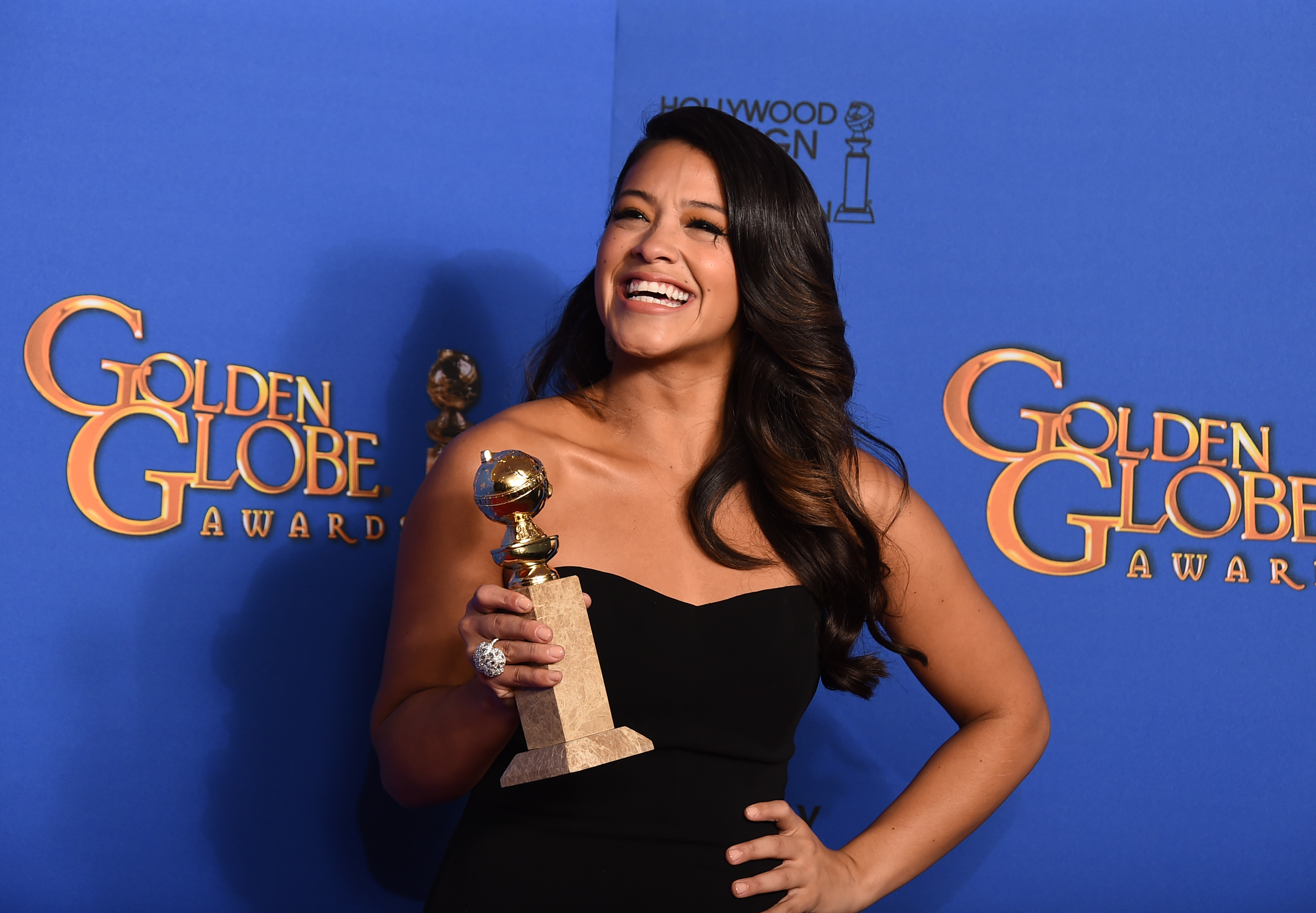 Gina Rodriguez poses with her award for best actress in a television series - musical or comedy for 'Jane the Virgin,' at the 72nd annual Golden Globe Awards in January 2015. (Photo by Jordan Strauss/Invision/AP, File)