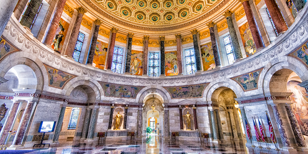 The Rotunda, facing south. At bottom near the center 2 of the 4 bronze statues by James Earl Fraser. Each statue represents one of the cardinal virtues of the Elks: Charity, Brotherly Love, Justice and Fidelity (first 2 pictured). Jason Marck/WBEZ