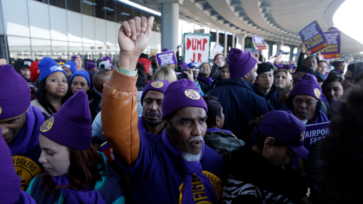 On Nov. 29, 2016, protesters gathered at Chicago's O'Hare International Airport as part of a nationwide protest for a $15 per hour minimum wage. Fast-food restaurant and airport workers, as well as home and child-care workers also rallied in cities including Detroit, Houston, Los Angeles, Minneapolis and New York City. (AP Photo/Kiichiro Sato)