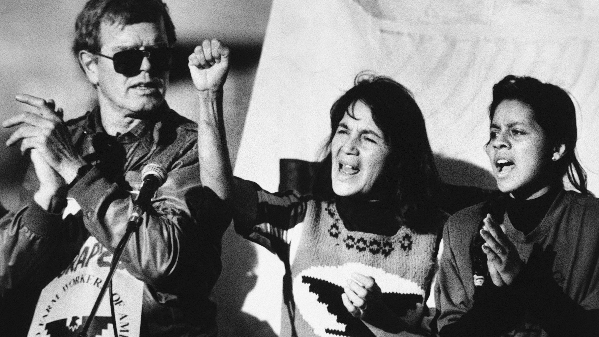 United Farm Workers leader Dolores Huerta (center) leads a rally along with Howard Wallace, President of the San Francisco chapter of the UFW (left) and Maria Elena Chavez, 16, the daughter of Cesar Chavez (right) in San Francisco's Mission District on Nov. 19, 1988. (AP Photo/Court Mast)