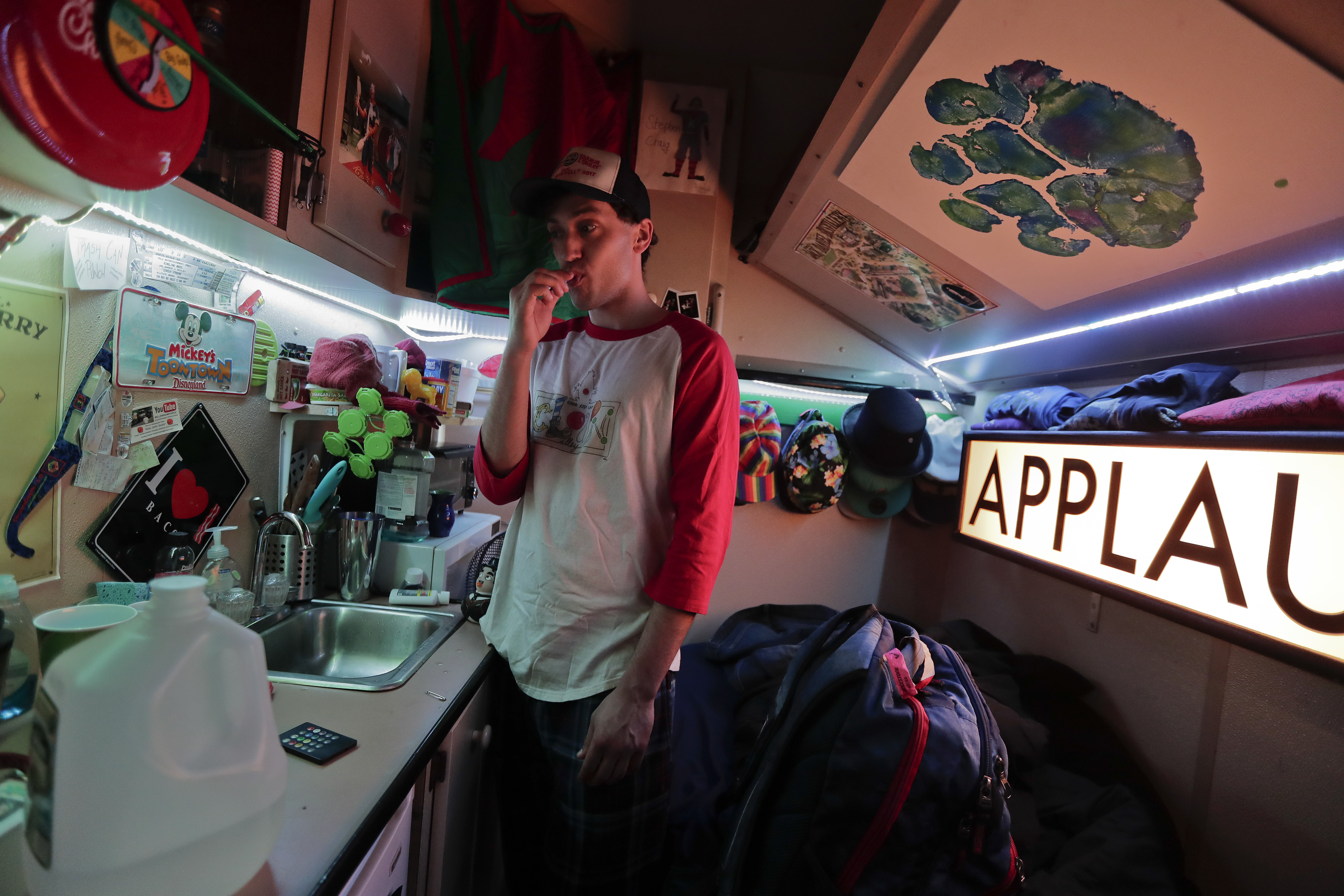 Ringling Bros. circus clown Stephen Craig brushes his teeth in his living compartment on the red unit's train before heading to the arena to perform in a show on May 4, 2017, in Providence, R.I. (Julie Jacobson/Associated Press)