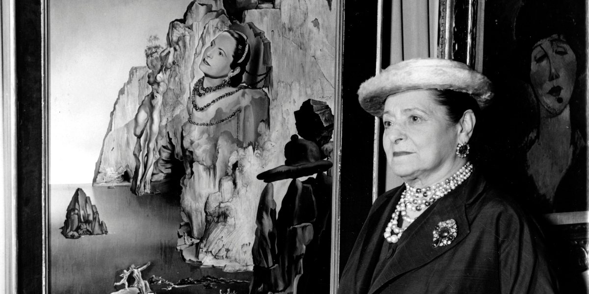 Helena Rubinstein poses beside her portrait by Salvador Dali in her art gallery on the top floor of the Gourielli triplex penthouse in New York City on Oct. 7, 1950. The oil painting is signed by her friend Dali and dated 1946. (AP Photo)