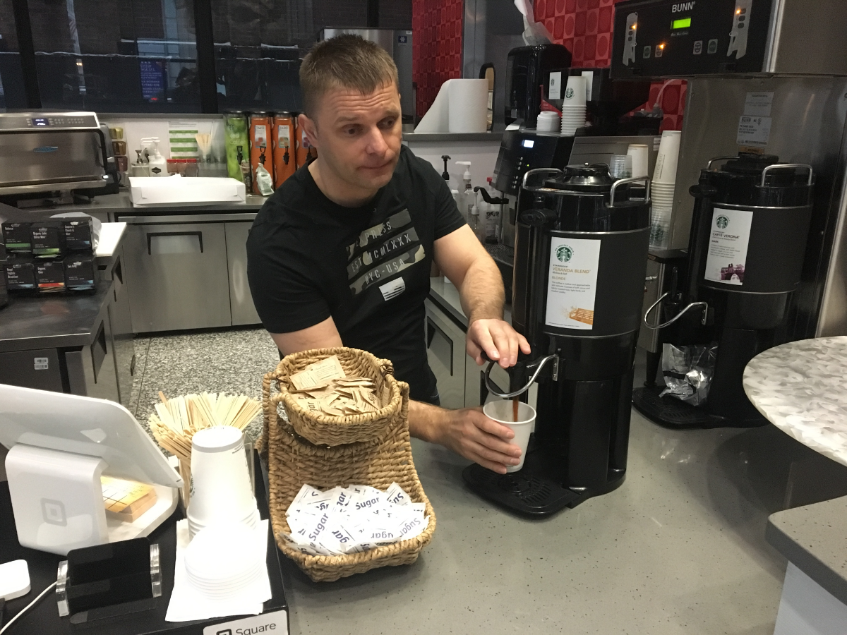 Janusz Leja runs Kava Cafe, located in the lobby of the Ralph H. Metcalfe Federal Building in downtown Chicago. This morning, he made free coffee available to employees in the building, many of whom he hadn't seen in more than one month. (Odette Yousef/WBEZ)
