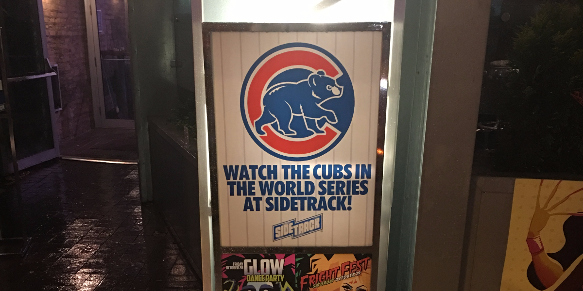 A sign outside the gay bar Sidetrack lists both Cubs- and Halloween-related events for the weekend.(Hunter Clauss/WBEZ)