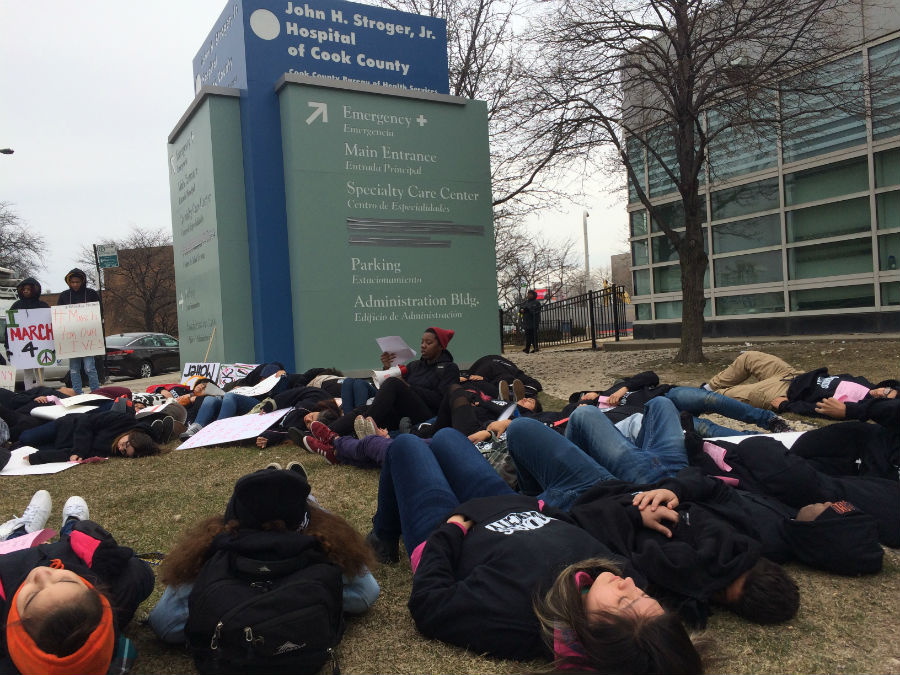 Youth from Good Kids Mad City staged a die-in outside the Stroger Hospital Emergency Room before joining the March for Our LIves.  (Linda Lutton/WBEZ)