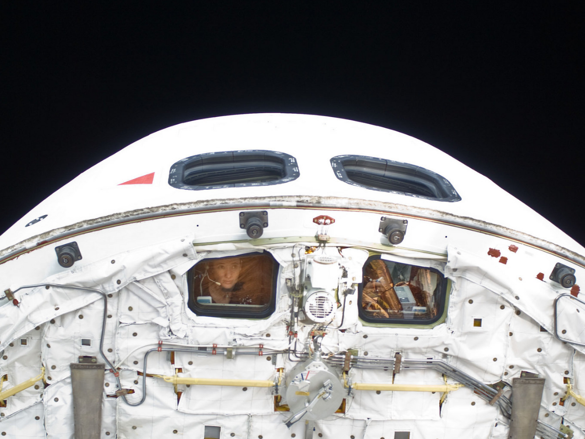 Astronaut Megan McArthur, STS-125 mission specialist, looks through a flight deck window of the Earth-orbiting Space Shuttle Atlantis on May 18, 2009. This image was photographed by one of the space walking astronauts during the mission's fifth and final session of extravehicular activity (EVA) as work continued to refurbish and upgrade the Hubble Space Telescope. (Photo courtesy of NASA)