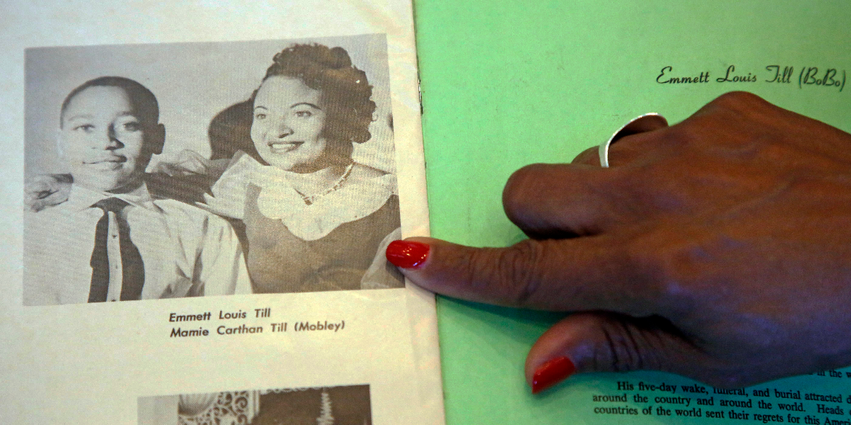 Deborah Watts, Emmett Till's cousin, points out a widely seen 1950s photograph of her cousin and his mother during a visit to Jackson, Miss., in conjunction with events in Mississippi and Illinois commemorating the 60th anniversary of the slaying of Till. (AP Photo/Rogelio V. Solis)
