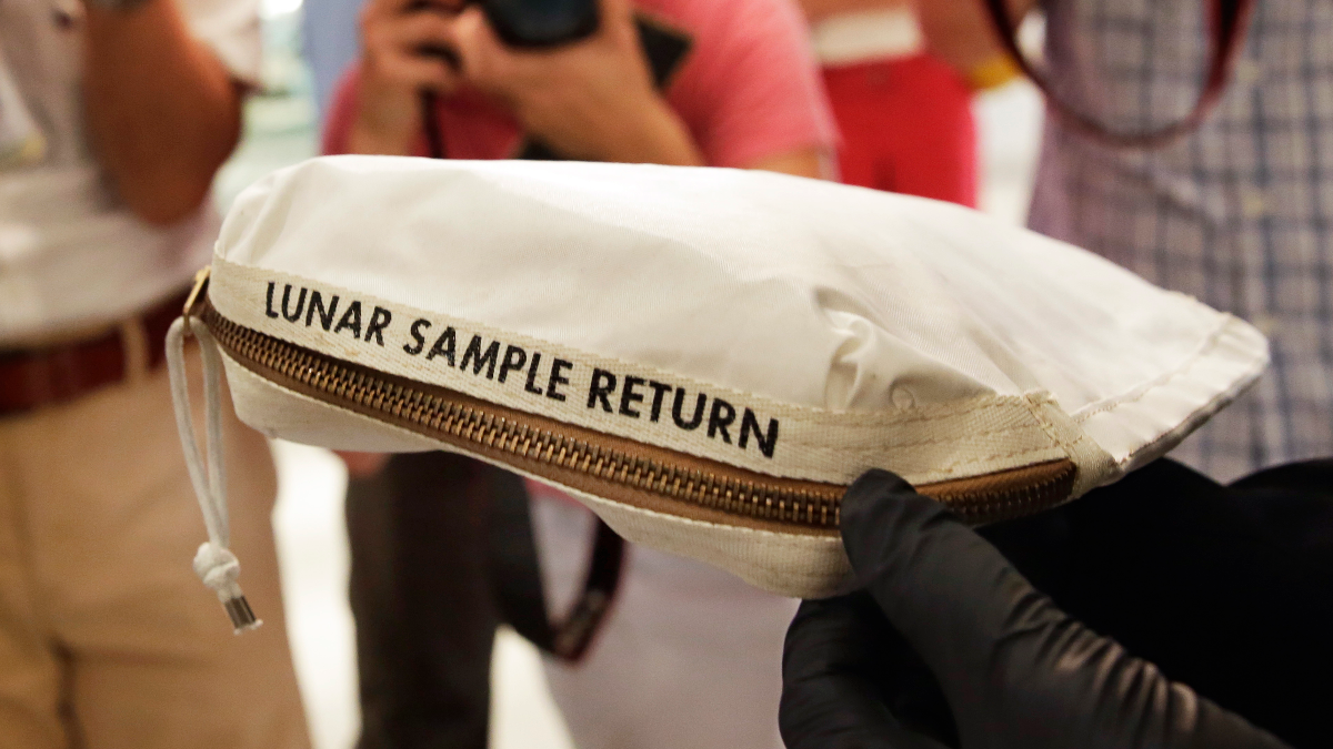 Lunar dust and some tiny rocks that Armstrong also collected are zipped up in a small bag and are worth an estimated $2 million to $4 million.(AP Photo/Richard Drew)