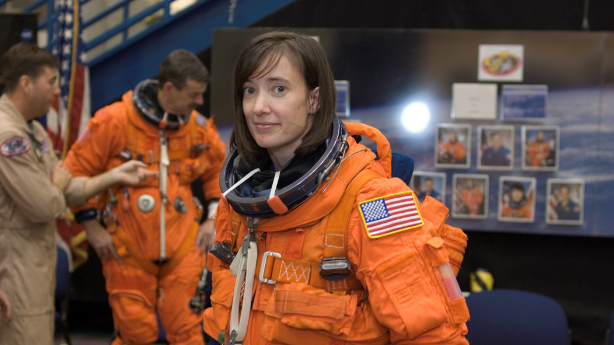 Wearing a training version of her shuttle launch and entry suit, astronaut Megan McArthur awaits the start of a training session at Johnson Space Center in January 2008. (Photo courtesy of NASA)