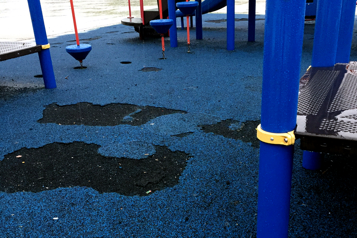 Money to repair the rubber flooring of the playground at Boone Elementary in West Ridge could also come out of the district's facilities budget. (Sarah Karp/WBEZ)