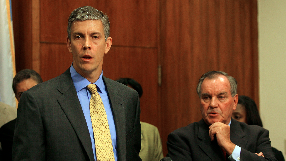 U.S. Secretary of Education Arne Duncan, left, addresses the media during a Chicago press conference with Mayor Richard Daley on Oct. 7, 2009. When Duncan was CPS CEO in the early 2000s, he and Daley adopted dramatic school reform approaches.(AP Photo/John Smierciak)