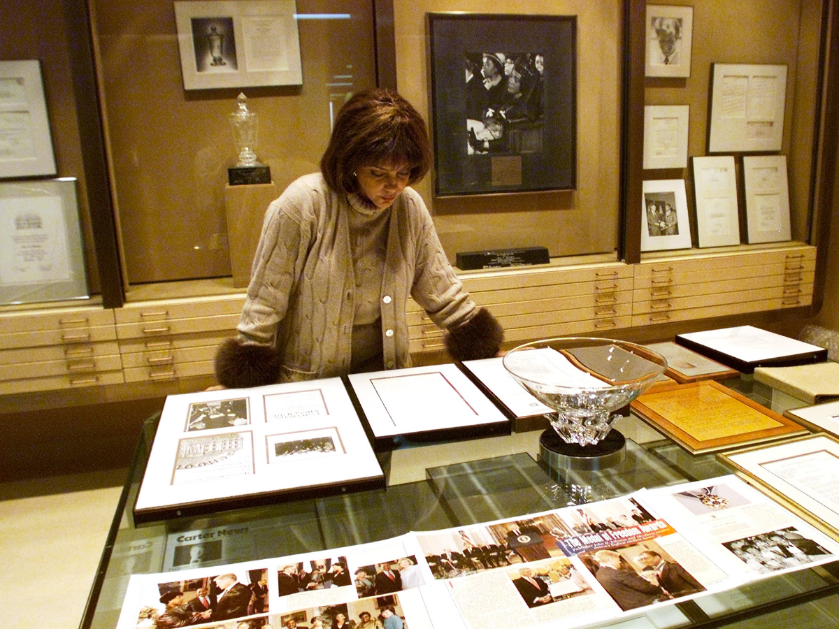 Linda Johnson Rice, then-president and chief operating officer of Jet magazine, looks over awards and recognitions won by the magazine in its 50-year lifetime in 2001.