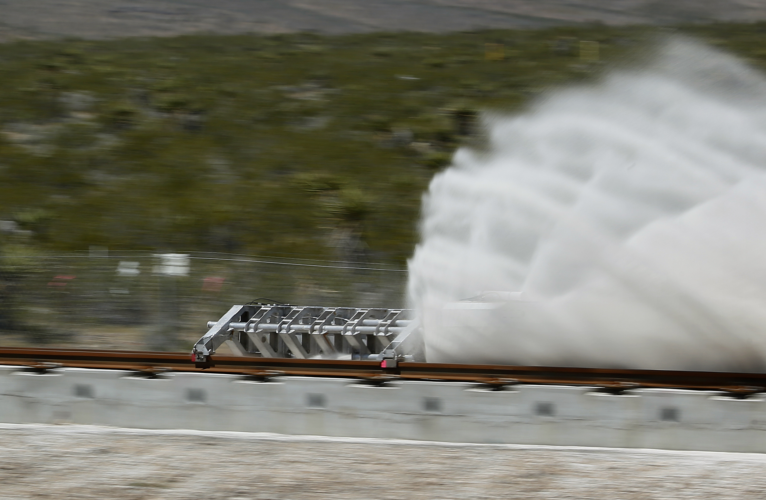 A sled speeds down a track during a test of a Hyperloop One propulsion system, Wednesday, May 11, 2016, in North Las Vegas, Nev. in the first public demonstration of technology for a super-speed, tube based transportation system. (AP Photo/John Locher)