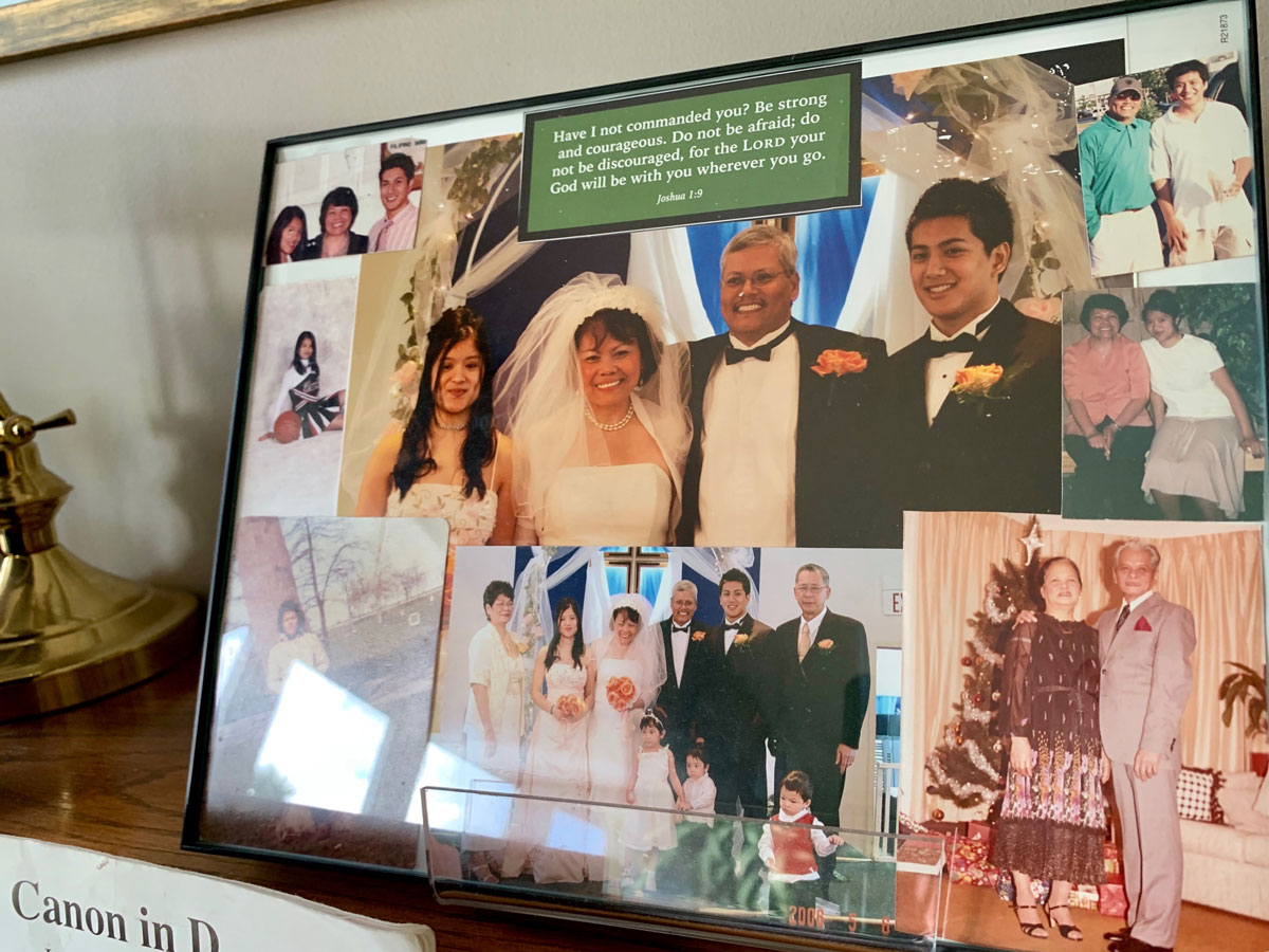 Photos of the Bartolome family are displayed at their home in Mount Prospect, Ill.