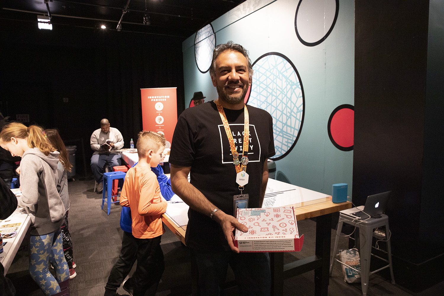 Manny Juarez, director of science and integrated strategies, holds one of the Innovation Studio's kits for children. (Arionne Nettles/WBEZ)