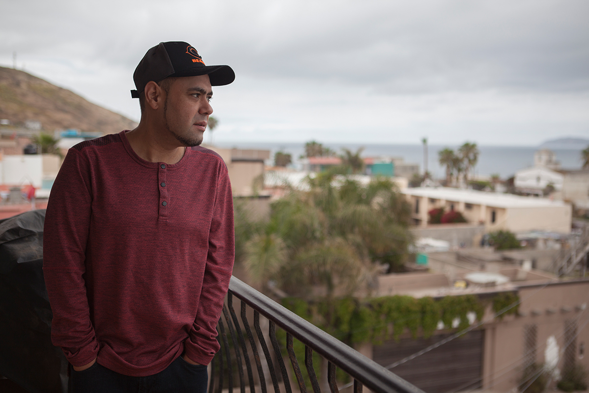Miguel Pérez looks out over Tijuana from his balcony.