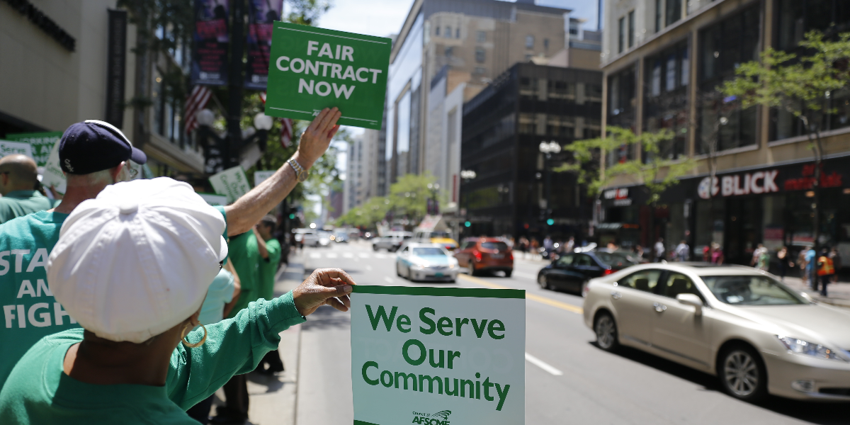 Members of the American Federation of State, County and Municipal Employees protest in Chicago on June 9, 2015 as their contract with the state was set to expire. (AP Photo/Christian K. Lee)