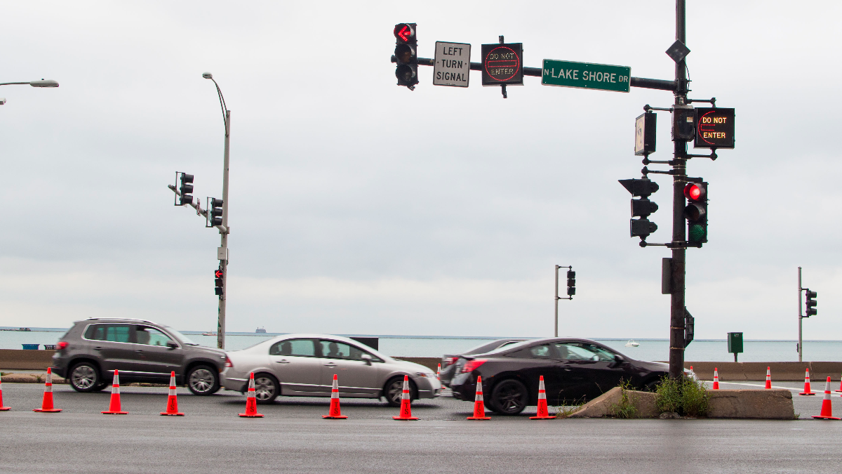 From 5 a.m. to 10 a.m. the Chicago Avenue and Lake Shore Drive intersection is blocked off with traffic cones, and the stoplight is programmed to stay green and keep traffic flowing on outer Lake Shore Drive. (Paula Friedrich/WBEZ)