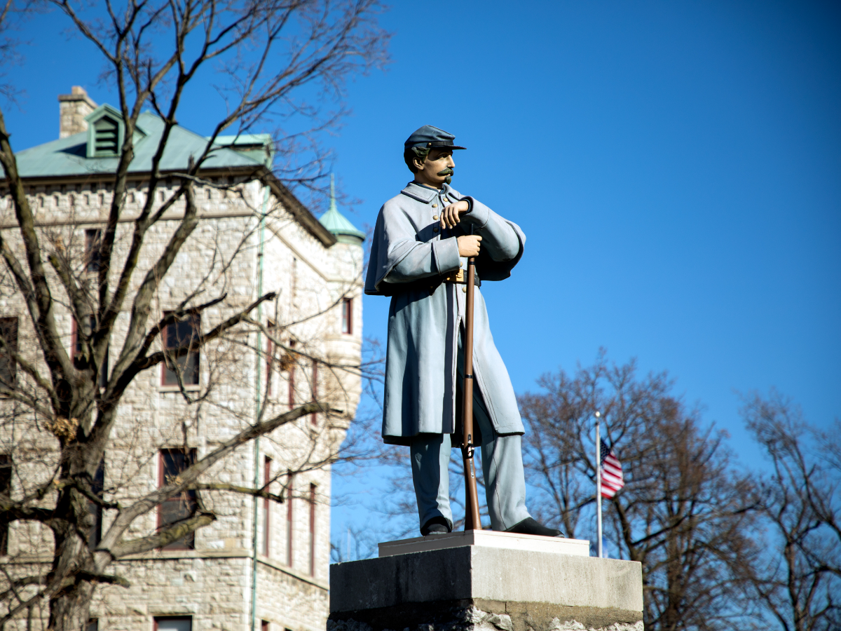 A statue of a Union Army soldier from the Civil War stands guard over the 210-acre campus of the Illinois Veterans Home about five hours southwest of Chicago. (Andrew Gill/WBEZ)