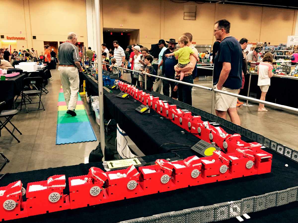 This June 2017 photo taken at Brickworld Chicago shows part of the long lineup of Great Ball Contraptions built from Legos for funneling mini Lego soccer balls from device to device. (Marcia Dunn/AP Photo)