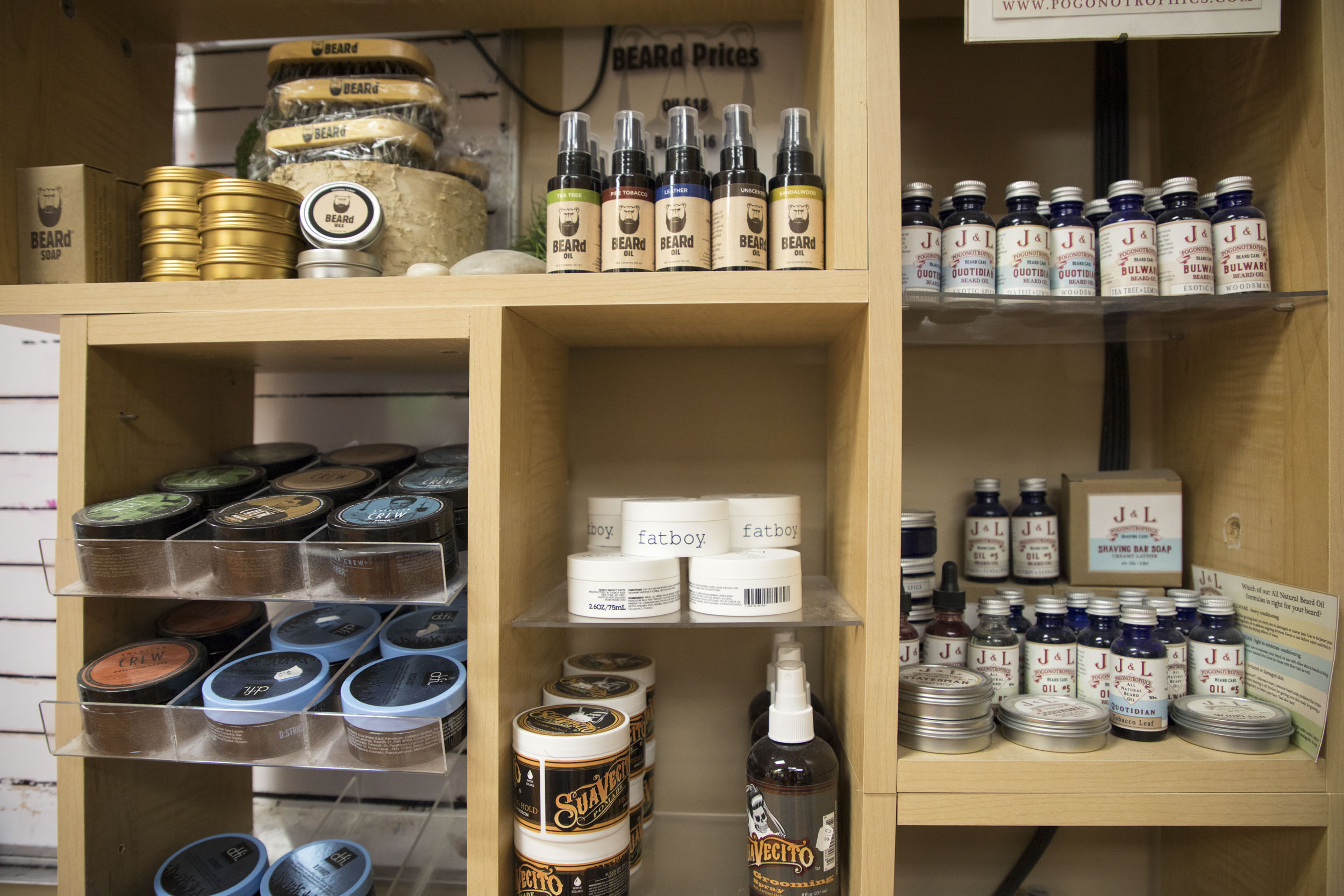 A wide variety of men's grooming products for sale at Father and Son barbershop, including a large selection for beard care. (Andrew Gill/WBEZ)