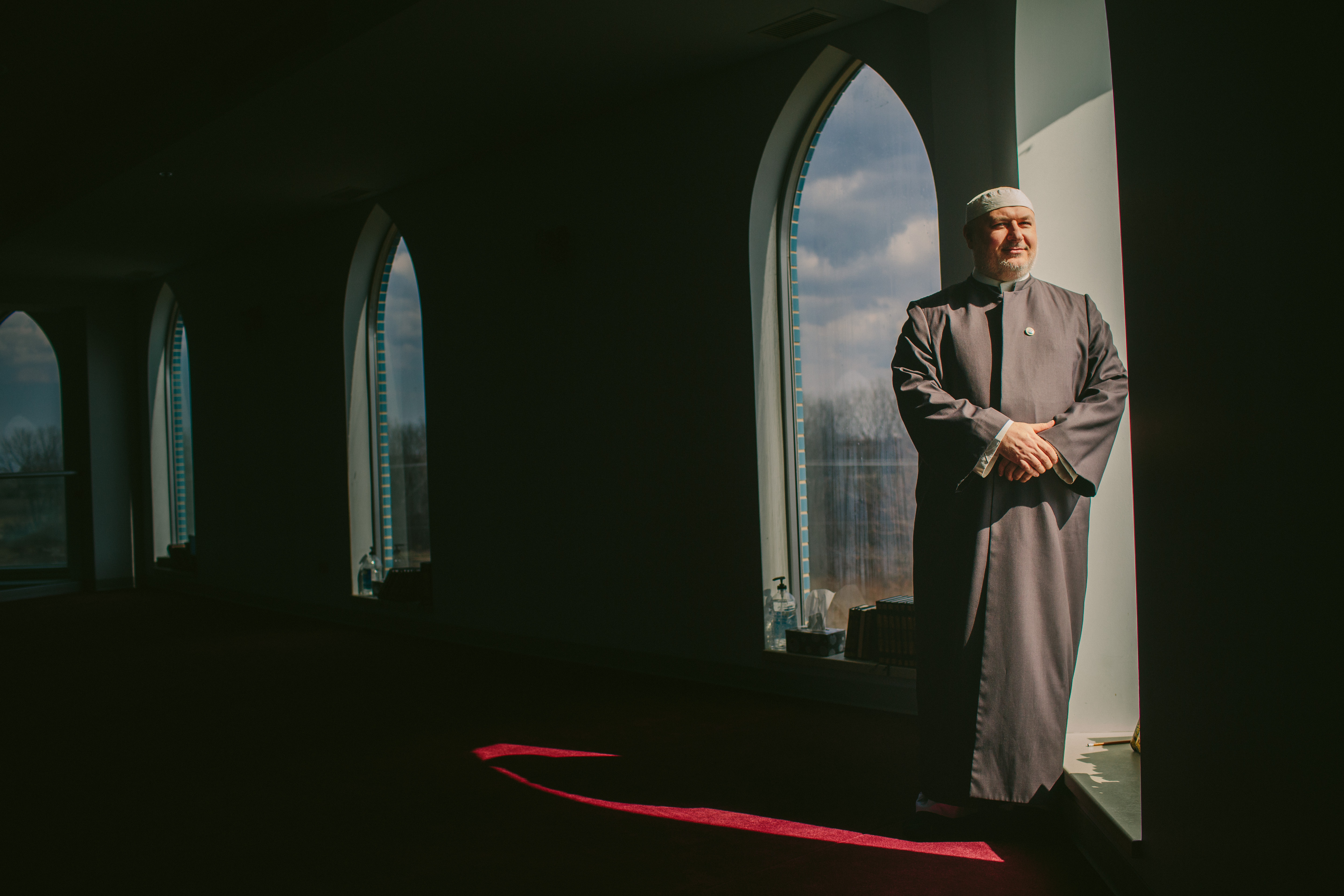 Imam Kifah Mustapha poses for a portrait in the mezzanine of The Pray Center of Orland Park. (Alyssa Schukar/For WBEZ)