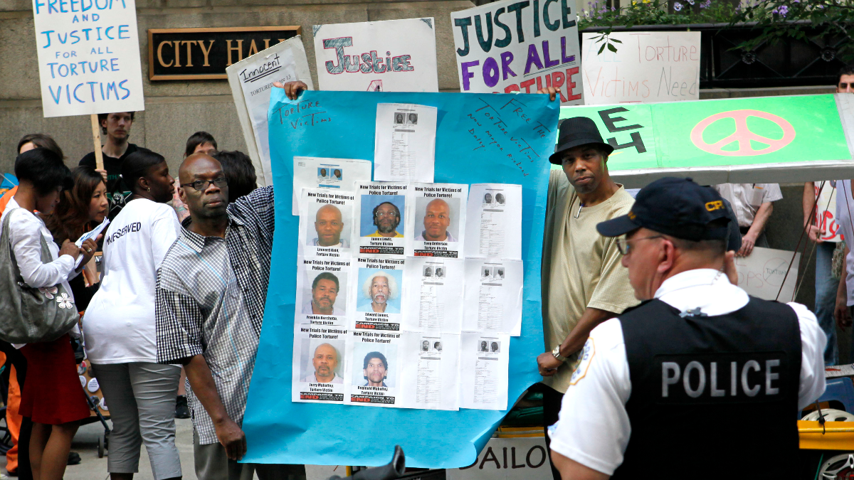 In 2010, protesters rallied against alleged police brutality and torture under former Chicago Police Cmdr. Jon Burge. (AP Photo/Charles Rex Arbogast)