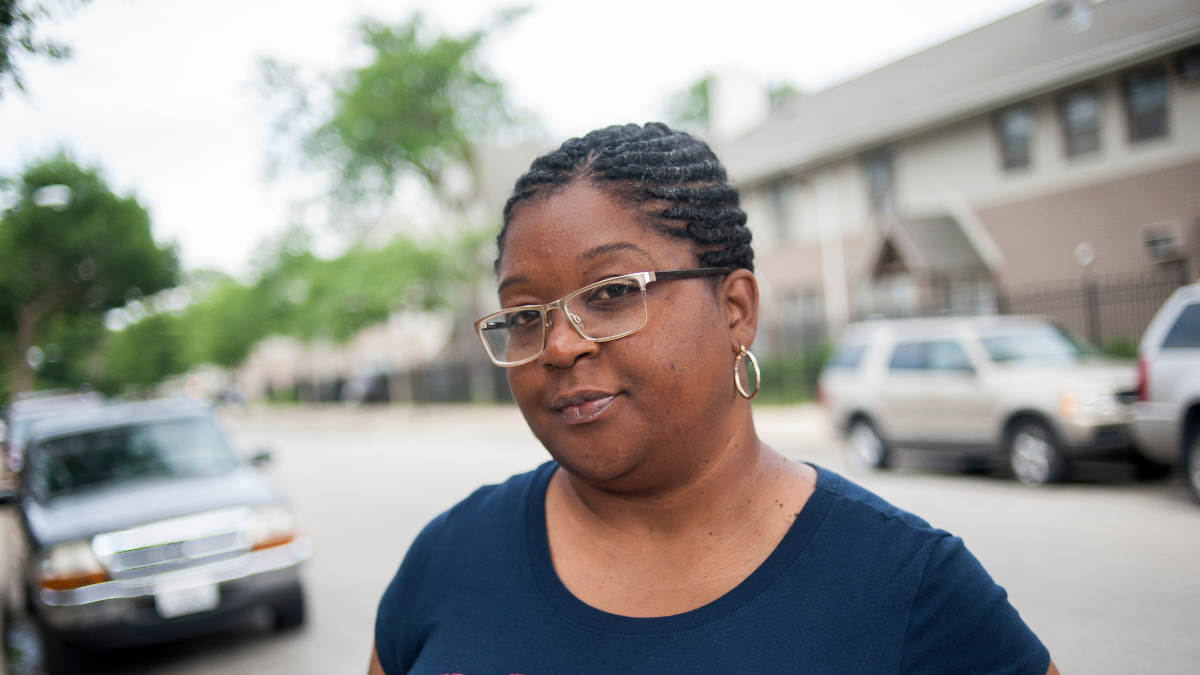 Tamiko Holt stands in front of some of the last remaining homes from the ABLA public housing complex, where she grew up. She says Section 8 voucher holders need to be seen differently before there's more neighborhood mobility. (Bill Healy/WBEZ)