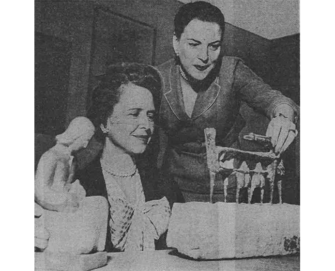 Mrs. J. Harris Ward and Mrs. J. Sanford Rose handle one of the rental gallery's sculptures featured in the spring 1959 collection. (Courtesy Chicago Sun-Times)