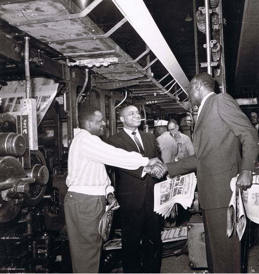 Chicago Defender publisher John H. Sengstacke celebrates a good run at the printing presses in 1960. Photo courtesy of the Chicago Defender/Obsidian Collection.