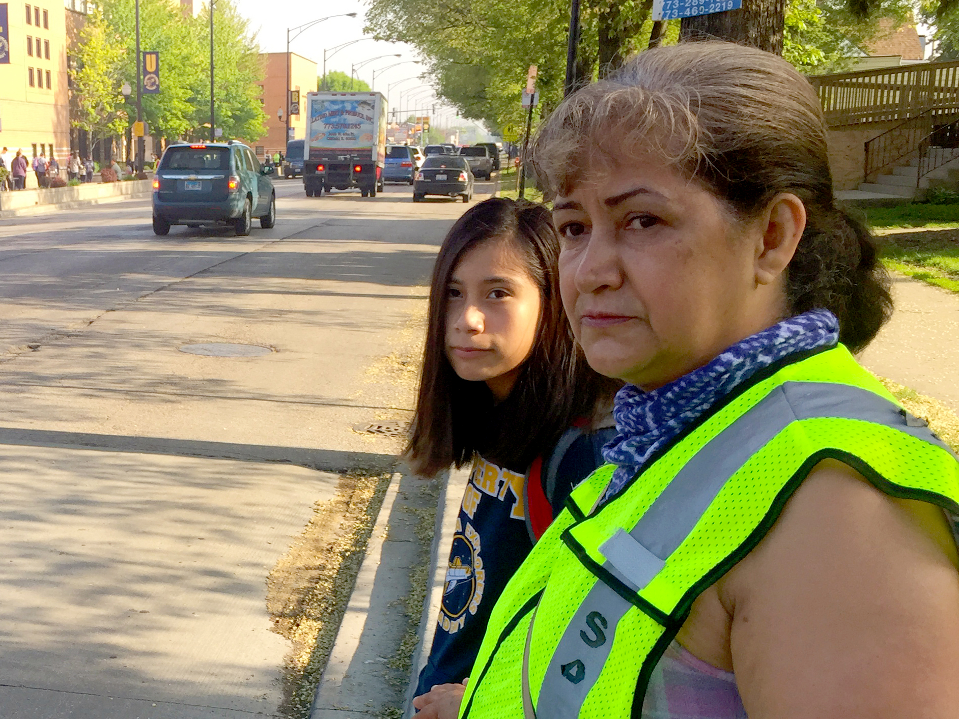 The moms on patrol look out for gang members and help students dodge traffic on their way to school. (Adriana Cardona-Maguigad/WBEZ)