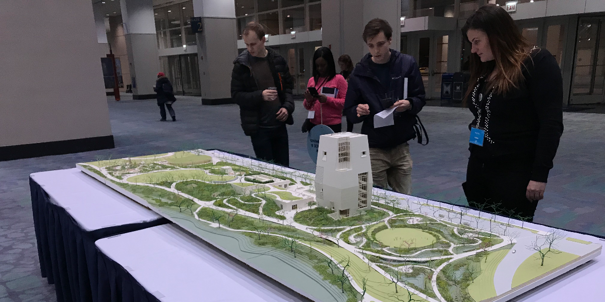 Obama Center public meeting attendees check out a model display, Tuesday, February 27, 2018.